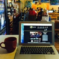 Laptop and Coffee at Coffee Shop